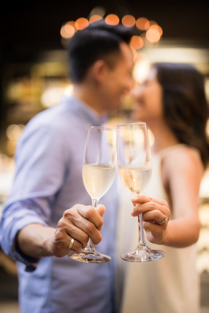 selective focus photography of couple holding cocktail glasses