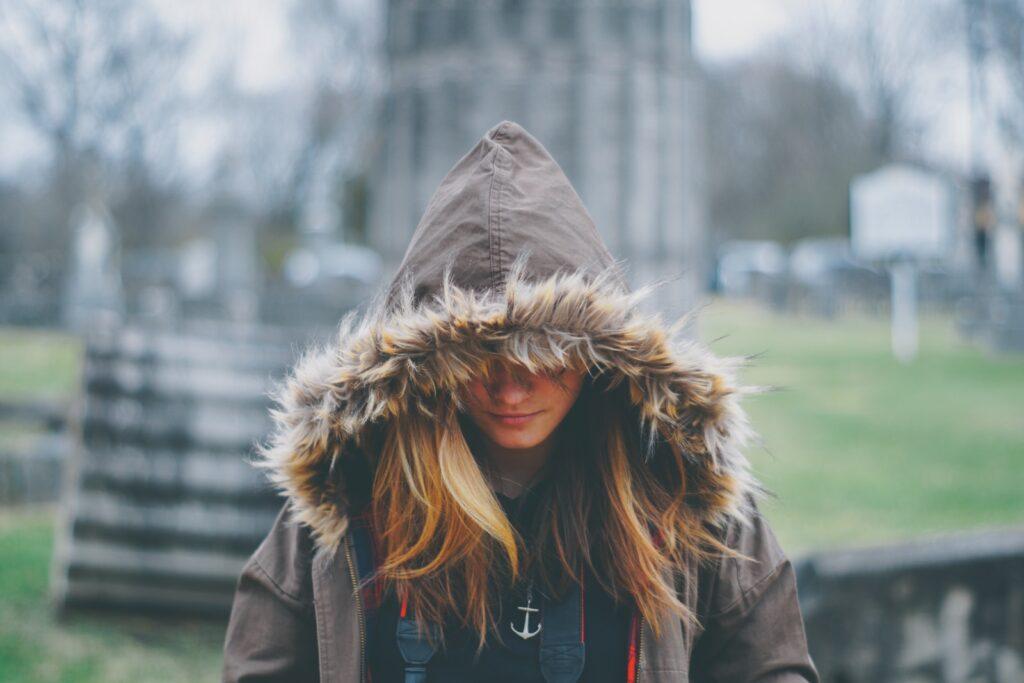 woman wearing brown and gray fur hoodie