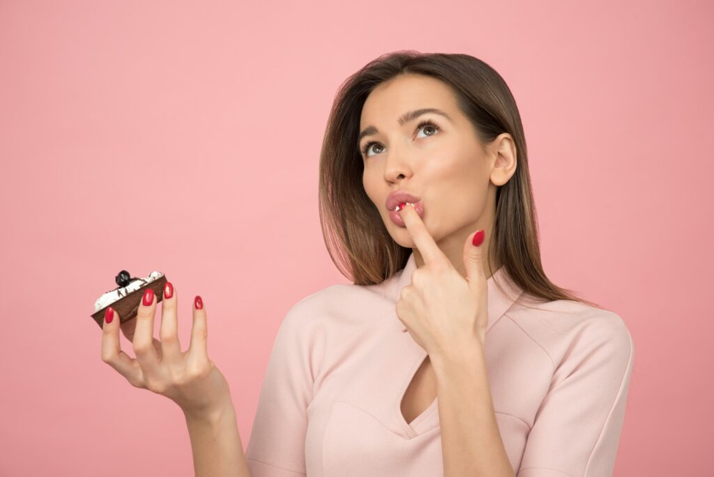 woman holding cake looking up
