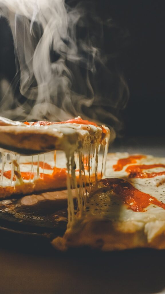 close up photo of pizza with cheese